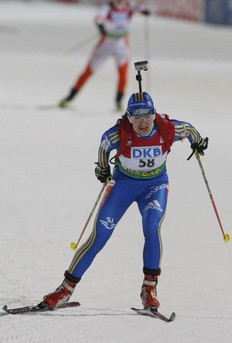 Anna Carin Olofsson-Zidek of Sweden sprints to the finish line during the women's 15 km individual race at the IBU Biathlon World Championships in Pyeongchang, east of Seoul February 18, 2009.