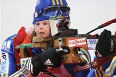 Anna Carin Olofsson-Zidek of Sweden shoots during a mixed relay race at the Biathlon World Championships in Pyeongchang, South Korea, Thursday, Feb. 19, 2009. Sweden finished second in the event.