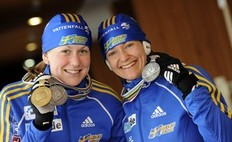 PYEONGCHANG, SOUTH KOREA - FEBRUARY 20: Anna Carin Olofsson-Zidek of Sweden and Helena Jonsson of Sweden pose during the medal shooting at the IBU Biathlon World Chanpionships on February 20, 2009 in Pyeong Chang, Korea.