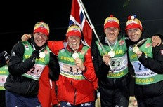 PYEONGCHANG, SOUTH KOREA - FEBRUARY 22: (L-R) Emil Hegle Svendsen, Halvard Hanevold, Lars Berger and Ole Einar Bjoerndalen of Norway take first place during the IBU Biathlon World Championships Men's Relay event on February 22, 2009 in Pyeongchang, Korea.