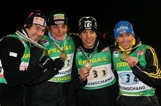 PYEONGCHANG, SOUTH KOREA - FEBRUARY 22: (L to R) Michael Roesch, Christoph Stephan, Arnd Peiffer and Michael Greis of Germany pose with the bronze medal after the Men's 4x 7, 5 km relay of the IBU Biathlon World Championships on February 22, 2009 in Pyeongchang, South Korea.