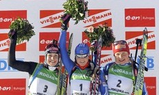 First placed Svetlana Sleptsova (1) of Russia, second placed Magdalena Neuner (3) of Germany and third placed Anna Bogaliy-Titovets of Russia celebrate on the podium after the Biathlon World Cup women's 10 km pursuit competition in Pokljuka December 20, 2009.