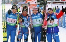 OBERHOF, GERMANY — JANUARY 06: The team of Russia (L-R) Anna Bogaliy Titovets, Svetlana Sleptsova, Anna Boulygina and Olga Medvedtseva pose after winning the Women's 4 x 6km Relay in the e.on Ruhrgas IBU Biathlon World Cup on January 6, 2010 in Oberhof, Germany.