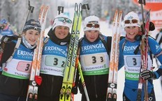 OBERHOF, GERMANY - JANUARY 06: The team of France (L-R) Marie Laure Brunet, Sylvie Becaert, Marie Dorin, Sandrine Bailly pose after winning the third place in the Women's 4 x 6km Relay in the e.on Ruhrgas IBU Biathlon World Cup on January 6, 2010 in Oberhof, Germany.