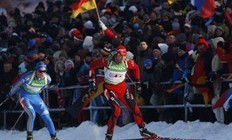 Norway's Halvard Hanevold skis ahead of Sweden's Fredrik Lindstroem (L) during the 4x7, 5 km men's relay competition at the Biathlon World Cup in the eastern German ski resort of Oberhof, January 7, 2010. Team Norway won the competition ahead of France and Germany.