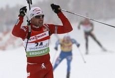 Poland's Tomasz Sikora celebrates his third place in the men's 15 km mass start competition at the Biathlon World Cup in the eastern German ski resort of Oberhof, January 10, 2010. Norway's Ole Einar Bjoerndalen won the competition, Tim Burke of the U.S. placed second and Sikora placed third.