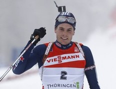 Tim Burke of the U.S. celebrates his second place in the men's 15 km mass start competition at the Biathlon World Cup in the eastern German ski resort of Oberhof, January 10, 2010. Norway's Ole Einar Bjoerndalen won the competition, Burke placed second and Poland's Tomasz Sikora placed third.