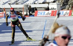 Germany's Magdalena Neuner (L) reacts after crossing the finish line for the women's 7.5km sprint at the Biathlon World Cup in Anterselva, northwest Italy, January 22, 2010. Neuner won ahead her second-placed compatriot Andrea Henkel and third-placed Sandrine Bailly of France.