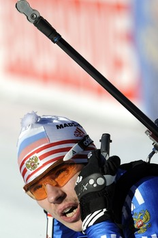Russia's Evgeny Ustygov looks at a screen after crossing the finish line at the men's 10km sprint Biathlon World Cup in Anterselva, northwest Italy, January 23, 2010. Russia's Ustygov retained overall leader's yellow jersey as Germany's Arnd Peiffer won ahead of Austria's Dominik Landertinger and Germany's Christoph Stephan.