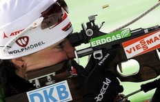 Germany's Andrea Henkel shoots as she competes during the women's 10 km pursuit Biathlon World Cup in Anterselva, northwest Italy January 24, 2010. Henkel won ahead of teammate Magdalena Neuner and Norway's Ann Kristin Aafedt Flatland.