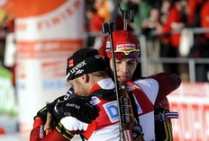 Austria's Daniel Mesotitsch (L) is congratulated by Germany's Peiffer after he wins the men's 12.5 km pursuit Biathlon World Cup in Anterselva, northwest Italy January 24, 2010. Austria's Daniel Mesotitsch won ahead Germany's Arnd Peiffer and Austria's Dominik Landertinger.