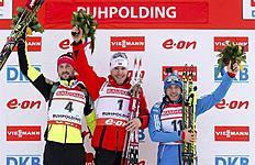 Ruhpolding (Germany), 12/01/2014.- Norway's winner Emil Hegle Svendsen (C), second-placed Jakov Fak of Slovenia (L) and third-placed Evgeniy Garanichev...
