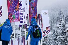 People walk to the Mountain Olympic Village at Laura Cross-country Ski & Biathlon Center of the Sochi 2014 Winter Olympics, Friday, Jan. 31, 2014, in Krasnaya...