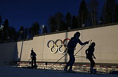 Olympic skiers take part in a biathlon training session for the 2014 Sochi Winter Olympic Games at the �Laura� cross-country and biathlon centre in Rosa...