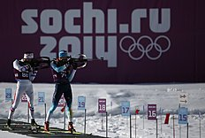 France's Desthieux and Ukraine's Semenov take part in a biathlon training session for the 2014 Sochi Winter Olympic Games at the �Laura� cross-country...