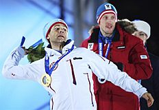 . Sochi (Russian Federation), 09/02/2014.- Gold medalist Ole Einar Bjoerndalen of Norway throws flowers into the crowd after the medal ceremony for the...