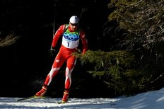WHISTLER, BC — FEBRUARY 18: Tomasz Sikora of Poland competes during the Biathlon Men's 20 km individual on day 7 of the 2010 Vancouver Winter Olympics at Whistler Olympic Park Biathlon Stadium on February 18, 2010 in Whistler, Canada.