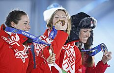 Medallists celebrate during the victory ceremony for the women's biathlon individual 15 km event at the Sochi 2014 Winter Olympics in Sochi