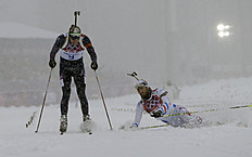 Norway's Emil Hegle Svendsen, left, outsprints France's Martin Fourcade to win the men's biathlon 15k mass-start, at the 2014 Winter Olympics, Tuesday,...