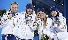 Silver medallists Vitkova, Soukalova, Soukup and Moravec of the Czech Republic pose during the award ceremony for the mixed biathlon relay at the Sochi...