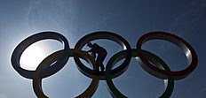 ОИ-2014 в Сочи (Olympic Winter Games, Sochi, Russia): A visitor climbs on the Olympic rings for a photograph after the 2014 Winter Olympics, Monday, Feb. 24, 2014, in Sochi, Russia. (AP Photo/Matt Slocum)