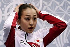 Зимние Олимпийские Игры 2014 в Сочи (Olympic Winter Games, Sochi, Russia): Mao Asada of Japan waits in the results area after completing her routine in the women's free skate figure skating finals at the Iceberg Skating Palace...