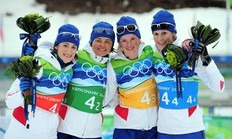 WHISTLER, BC — FEBRUARY 23: (L to R) Marie Laure Brunet, Sylvie Becaert, Marie Dorin and Sandrine Bailly of France celebrate after winning the silver medal during the women's biathlon 4 x 6km relay on day 12 of the 2010 Vancouver Winter Olympics at Whistler Olympic Park Cross-Country Stadium on February 23, 2010 in Whistler, Canada.