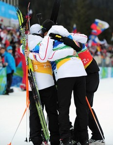 WHISTLER, BC — FEBRUARY 23: The German team of Kati Wilhelm, Simone Hauswald, Martina Beck and Andrea Henkel of Germany celebrate after winning the bronze medal during the women's biathlon 4 x 6km relay on day 12 of the 2010 Vancouver Winter Olympics at Whistler Olympic Park Cross-Country Stadium on February 23, 2010 in Whistler, Canada.