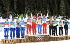 WHISTLER OLYMPIC PARK, CANADA — FEBRUARY 23: Team Russia (Anna Bogaliy-Titovets, Olga Medvedtseva, Olga Zaitseva, Svetiana Sleptsova) takes the Gold Medal, Team France (Sylvie Becaert, Sandrine Bailly, Sylvie Becaert, Marie Dorin) takes the Silver Medal, Team Germany (Andrea Henkl, Kati Wilhelm, Simone Hauswald, Martina Beck) takes the Bronze Medal during the Women's Biathlon 4x6km Relay on Day 12 of the 2010 Vancouver Winter Olympic Games on February 23, 2010 in Whistler Olympic Park, Canada.