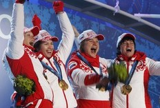 Gold medallists Olga Zaitseva, Olga Medvedtseva, Anna Bogaliy-Titovets and Svetlana Sleptsova of Russia celebrate during the medal ceremony for the women's biathlon 4x6km relay at the Vancouver 2010 Winter Olympics, in Whistler, British Columbia, February 23, 2010.