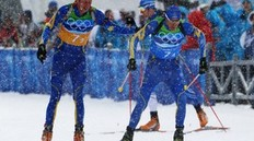 WHISTLER, BC - FEBRUARY 26: Mattias Nilsson (L) and Bjorn Ferry of Sweden compete during the men's 4 x 7.5 km biathlon relay on day 15 of the 2010 Vancouver Winter Olympics at Whistler Olympic Park Cross-Country Stadium on February 26, 2010 in Whistler, Canada.