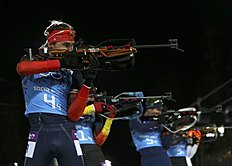 Russia's Shipulin shoots during men's biathlon 4 x 7.5 km relay at Sochi 2014 Winter Olympic Games