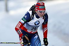 Russia's Yana Romanova competes in the women's 7.5km sprint at the biathlon World Cup competition in Pokljuka, Slovenia, Thursday, March 6, 2014...