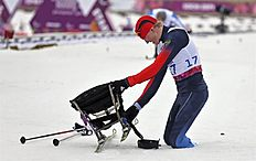 . Krasnaya Polyana (Russian Federation), 09/03/2014.- Aleksandr Davidovich of Russia checks his slide after finnishing the Cross Country Men's 15km Sitting...