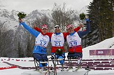 Krasnaya Polyana (Russian Federation), 09/03/2014.- Gold medalist Roman Petushkov of Russia (C), silver medalist Irek Zaripov of Russia (R) and...