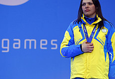 Ukraine's Olena Iurkovska covers her bronze medal with her hand after finishing third in the women's biathlon 12,5 km sitting during a medal ceremony at...