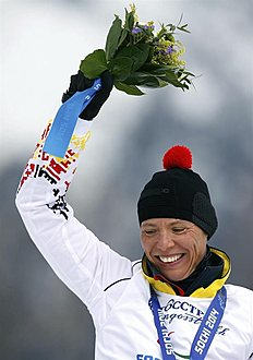 Krasnaya Polyana (Russian Federation), 16/03/2014.- Gold medalist Andrea Eskau of Germany celebrates during the medal ceremony after the Cross Country...