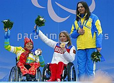 Ukraine's Olena Iurkovska covers her bronze medal with her hand after finishing third in the women's biathlon 12,5 km sitting event as she and first place...