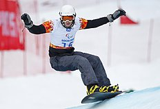 Snowboard (сноуборд): Denis Colle of Belgium competes during men's para snowboard cross, standing event at the 2014 Winter Paralympic, Friday, March 14, 2014, in Krasnaya Polyana,...