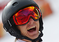Snowboard (сноуборд): Evan Strong of United States celebrates his victory in the men's para snowboard cross, standing event at the 2014 Winter Paralympic, Friday, March 14,...