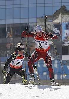 Moscow (Russian Federation), 05/04/2014.- Tora Berger of Norway (R) and Marie Dorin of France (L) compete during the Women's Mass Start race at...