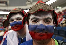 ������ � ������: Russia's supporters celebrate their team's victory against Sweden after their men's ice hockey World Championship semi-final game at Minsk Arena in Minsk...