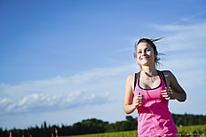 fitness sport healthy and cheerful young woman running outdoor