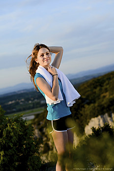 fitness sport healthy cheerful young woman running outdoor countryside landscape