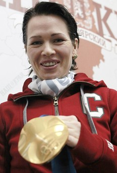 Olga Medvedtseva of Russia shows her gold medal during a news conference in Russia's Siberian city of Krasnoyarsk March 3, 2010. Medvedtseva got her gold medal for the victory in women's biathlon 4x6km relay at the Vancouver 2010 Winter Olympics.