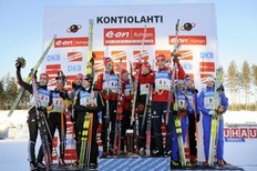 Germany's Kati Wilhelm (L), Erik Lesser, Simon Schempp and Magdalena Neuner, Norway's Tarjei Boe, Tora Berger, Ann Kristin Flatland and Halvard Hanevold and Italy's Katja Haller (r), Lukas Hofer, Karin Oberhofer and Christian De Lorenzi (behind Oberhofer) celebrate on the podium after the Mixed Relay (2 x 6 + 2 x 7, 5 km) during the biathlon IBU World Cup 2010 in Kontiolahti, Finland, on March 12, 2010. Norway won the competition ahead of second-placed Germany and third-placed Italy.