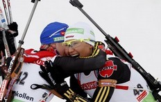 Germany's Simone Hauswald (R) is congratulated by team mate Martina Beck after she won the women's 7, 5 km sprint distance in the Holmenkollen World Cup biathlon event in Oslo, March 18, 2010.