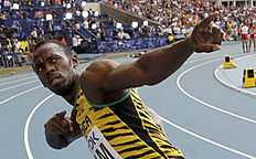 ������ �������� � ������: FILE � In this Aug. 18, 2013 file photo, Jamaica's Usain Bolt celebrates winning his third gold medal in the men's 4x100-meter relay at the World Athletics...