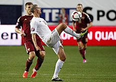 Liechtenstein's Frick fights for the ball against Russia's Kokorin during their Euro 2016 Group G qualifying soccer match at the Arena Khimki outside Moscow...