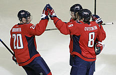 ������ � ������: Washington Capitals' Alex Ovechkin (8), of Russia, celebrates with teammates Mike Green,right, and Troy Brouwer (20) after he scored a goal during the...